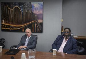 Legislative candidates Paul Harris, left, and Damion Jiles talk with members of The Columbian's Edit