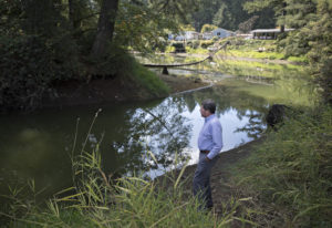 Camas city administrator Pete Capell looks over water that was diverted from Round Lake toward the m