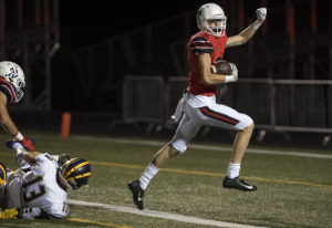 Camas' Jackson Clemmer (83) breaks away from Bellevue defense to score a touchdown during Frida