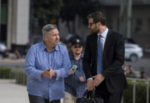 Former Vancouver pastor John Bishop, left, arrives to be sentenced for unlawful importation of a con