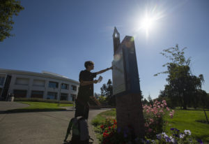 Second-year student Gage Beck of Vancouver gets a little help finding his way around campus during t