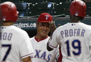 Texas Ranger interim manager Don Wakamatsu, center, congratulates Shin-Soo Choo and Jurickson Profar