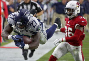 Seattle Seahawks running back Mike Davis (27) dives in for a touchdown as Arizona Cardinals defensiv