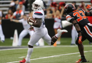 Arizona running back J.J. Taylor looks back at Oregon State's Jalen Moore as he heads to the end zon