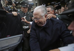 Fernando Karadima is escorted from a court, after testifying in a case that three of his victims bro
