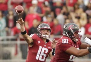 Washington State quarterback Gardner Minshew II (16) throws a pass during the first half of an NCAA