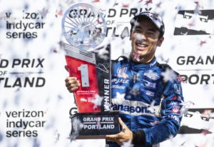 Takuma Sato celebrates his first-place finish at an IndyCar auto race, Sunday, Sept. 2, 2018, in Por