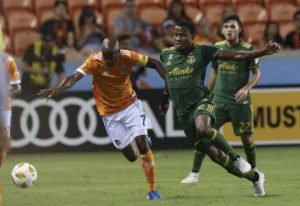 Houston Dynamo defender DaMarcus Beasley (7) and Portland Timbers defender Alvas Powell (2) battle f