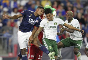New England Revolution defender Michael Mancienne, left and New England Revolution goalkeeper Matt T