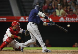 Seattle Mariners' Robinson Cano connects for a three-run double during the eighth inning of a baseba