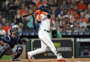 Houston Astros' Marwin Gonzalez, right, hits a two-run home run as Seattle Mariners catcher Chris He