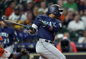 Seattle Mariners' Robinson Cano, right, hits a RBI single as Houston Astros catcher Martin Maldonado