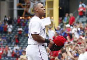 Texas Rangers' Adrian Beltre walks to the dugout after being relieved of his duties at third base du