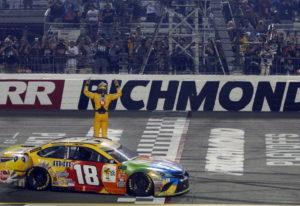 Kyle Busch (18) celebrates winning the NASCAR Cup Series auto race at Richmond Raceway in Richmond,