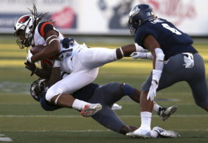 Oregon State's Christian Wallace (29) catches a first down pass in front of Nevada's Jomon Dotson (2