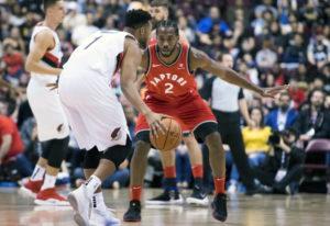 Toronto Raptors forward Kawhi Leonard (2) fights for control of the ball with Portland Trail Blazers