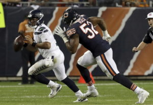 Chicago Bears linebacker Khalil Mack (52) chases Seattle Seahawks quarterback Russell Wilson (3) dur