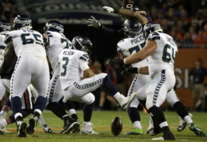 Seattle Seahawks quarterback Russell Wilson (3) loses a ball during the first half of an NFL footbal