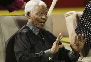 Nelson Mandela gestures during the 5th annual Nelson Mandela Lecture at the Linder Auditorium in Joh