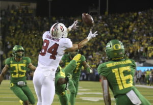 Stanford's Colby Parkinson, center, pulls down a touchdown pass in overtime against Oregon during NC