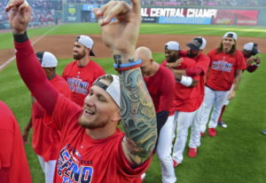 Cleveland Indians' Brandon Barnes celebrates after the Indians defeated the Detroit Tigers 15-0 to c