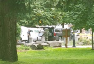 A Vancouver Police Department Bomb Unit officer responds to a call at Esther Short Park on Friday. A