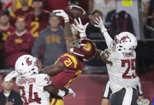 Southern California wide receiver Tyler Vaughns, center, misses a pass between Washington State safe