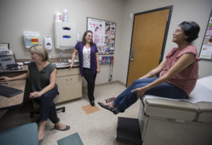 Dr. Anna Eckhardt, from left, joins Adrienne San Nicolas and Naomi Allen during a prenatal checkup f