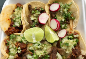 Pastor, asada, lengua and pollo tacos from Delicious Tacos.