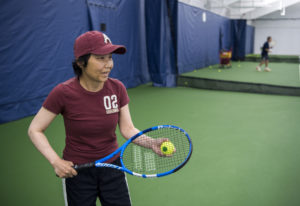 Akemi Noll plays tennis with her husband, Joe, at Vancouver Tennis Center. She was diagnosed with Pa