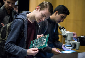 Cody Wold, senior at Evergreen High School, checks out circuit boards at the Silicon Forest Electron