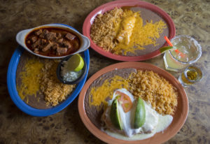 The chili colorado, from left, with chicken enchiladas, the El Jefe margarita and the seafood chimic