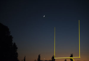 The moon rises over the Woodland, Ridgefield game at Woodland High School on Friday night, Oct. 12,