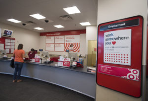 A sign advertises careers available at the Hazel Dell Target as engagement advocate Daphne Jones, in