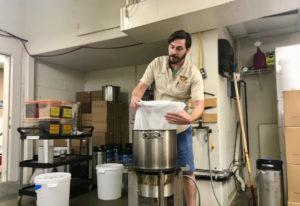 Instructor Andrew Reudink steeps grains at Bader Beer and Wine Supply. Rachel Pinsky