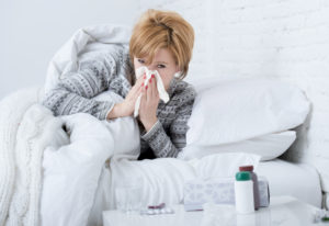 The influenza virus hijacks human cells in the nose and throat to make copies of itself. Dreamstime