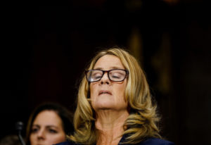 Christine Blasey Ford takes a breath at a Senate Judiciary Committee hearing Sept. 27 on Capitol Hil