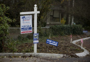 For sale signs are seen along Northwest 108th Circle in Hazel Dell in November 2016. Amanda Cowan/Th