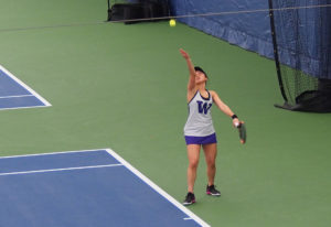 Washington junior Natsuho Arakawa serves during play at the Portland-Seattle Battle college women&#0