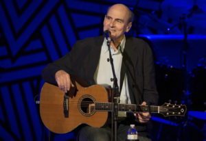 James Taylor performs at Amalie Arena in 2014 in Tampa, Fla. Taylor wants to raise money to help peo