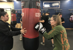 Carol Auer of Batavia, Ill., who has Parkinson's disease, practices her boxing skills at an open hou