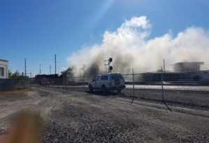 A BNSF rail car burns after catching fire around 12:50 p.m. Sunday. A spokesperson for the company c