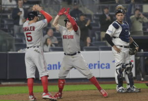 Boston Red Sox's Brock Holt, center, celebrates with Ian Kinsler (5) after hitting a two-run home ru