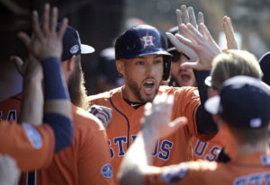 Houston Astros' George Springer is congratulated by teammates after hitting a solo home run off