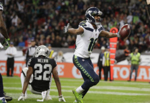 Seattle Seahawks wide receiver Tyler Lockett (16) celebrates after scoring a touchdown during the se