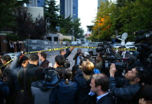 Members of the media work on the blocked road leading to Saudi Arabia's Consulate in Istanbul,
