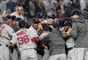 The Boston Red Sox celebrate after beating the New York Yankees 4-3 in Game 4 of baseball's American