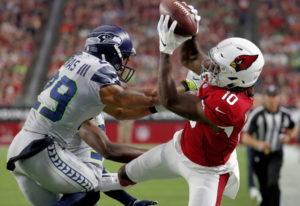 Arizona Cardinals wide receiver Chad Williams (10) makes the catch as Seattle Seahawks defensive bac