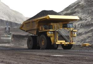FILE - In this April 4, 2013, file photo, a mining dumper truck hauls coal at Cloud Peak Energy's Sp