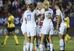 Teammates celebrate after United States midfielder Julie Ertz (facing camera) scored a goal during t